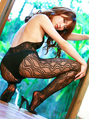Saki Yamaguchi Asian in lace outfit shows hot curves at window - Japarn porn pics at JapHole.com