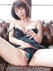 Izumi Manaka in black lingerie enjoys vibrator and sucks shlong - Japarn porn pics at JapHole.com