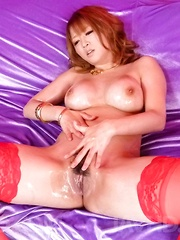 Yuki Touma Asian fingers her oiled nooky while giving blowjob