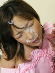 While on her knees Yui Ayana is cumed onto. - Japarn porn pics at JapHole.com