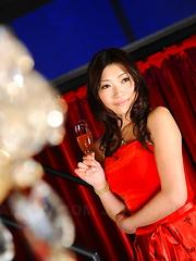 Arousing Karin Kusunoki poses in red dress
