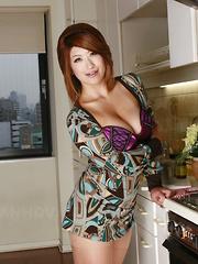 Sexy busty Miwa Nishiki poses in her kitchen - Japarn porn pics at JapHole.com
