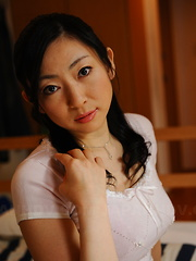 Hot babe Emiko Koike provokes with her gown - Japarn porn pics at JapHole.com