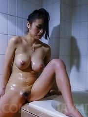 Kaede Niiyama caresses herself with oil and rubs cunt of bathtub - Japarn porn pics at JapHole.com