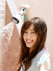 Rola Chen Asian plays with outdoor shower on body over lingerie - Japarn porn pics at JapHole.com