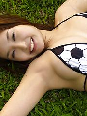 Saori Yamamoto Asian shows big boobs in football bra in the park - Japarn porn pics at JapHole.com